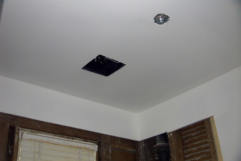 Compeleted drywall for the ceiling.  Square section is the new exhaust fan and the small circle is an electrical box for a penda