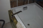 Detail of location of bathtub filler.  Off-set to the side in order to allow the second person in the tub to sit comfortably wit
